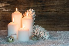 Festive burning Christmas candles stock images