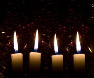Four Christmas candles Stock Images