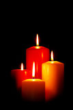 Four Christmas candles on black stock images