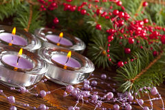 Four christmas candles and branch of xmas tree Royalty Free Stock Images