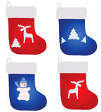 Four christmas footwears Stock Photo