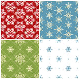 Four Christmas seamless patterns Royalty Free Stock Images