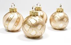 Four christmas tree balls. Four golden christmas tree balls on white Royalty Free Stock Photos