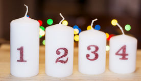 Four christmas white candles for home decoration Stock Images