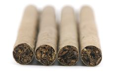 Four cigars. Closeup on white background Royalty Free Stock Images