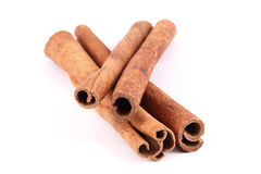 Four cinnamon sticks stacked. On white background Stock Image