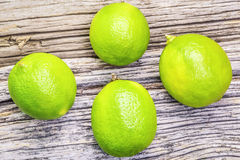 Four citrus lime fruits on wooden boards Royalty Free Stock Image