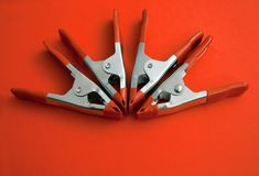 Four clamps Stock Images