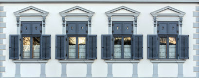 Four classic windows. Four classic jalousie windows in old house wall Royalty Free Stock Image