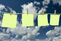 Four clean memo hanging on a cord. Royalty Free Stock Image