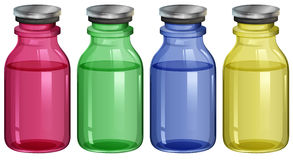 Four clear bottles Stock Photos