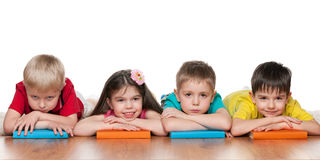 Four clever kids with books Stock Photo