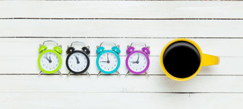 Four clocks and cup Royalty Free Stock Photography
