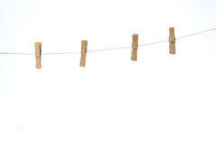 Four clothes peg. Attach to rope over white background Stock Photography