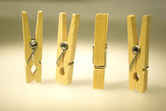 Four clothespins. On white table Royalty Free Stock Image