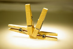Four clothespins. On white table Royalty Free Stock Photography