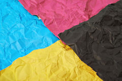 Four CMYK colored paper sheets Stock Photography