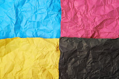 Four CMYK colored paper sheets Stock Photos
