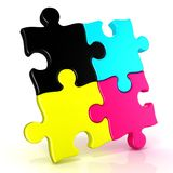 Four CMYK jigsaw puzzle pieces Royalty Free Stock Photos