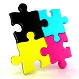 Four CMYK jigsaw puzzle pieces Royalty Free Stock Photos