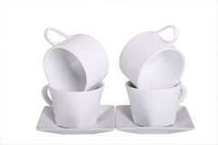 Four Coffee Cups. Four White Coffee Cups stacked on saucers Royalty Free Stock Photo