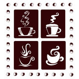 Four coffee cups. A set of decorated coffee cups in different styles Royalty Free Stock Photography