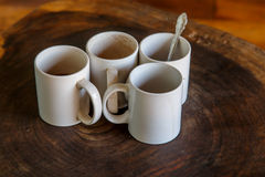 Four coffee cups in a table Royalty Free Stock Photos
