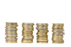 Four coin money piles (isolated) Royalty Free Stock Photography