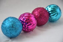 Four christmas balls. Pink. Blue Royalty Free Stock Photo
