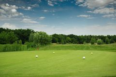 Four color balls on golf course, launching pad Stock Photography