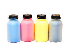 Four color bottles of a paint. With black stoppers Stock Images