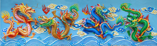 Four color chinese dragon. Statue, red green gold and blue chinese statue at the wall of chinese temple in Thailand Royalty Free Stock Image