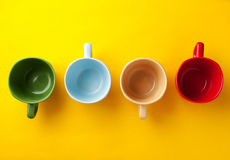 Four color coffee cups Stock Photos