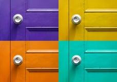 Four color of door in vintagea bstract art. Four color of door in vintage abstract art background Stock Photos