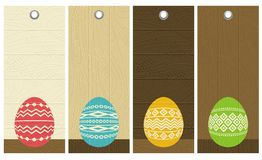 Four color easter eggs over wooden labels Stock Image