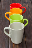 Four color empty tea cups arranged in one row Royalty Free Stock Image