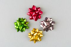 Four color festive bows over grey background Stock Photography