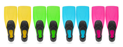 Four color flippers for diving. On white background. File contains a path to isolation Royalty Free Stock Photography
