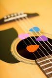 Four color guitar picks in strings Stock Photo