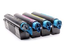 Four color laser printer toner cartridges royalty free stock photo