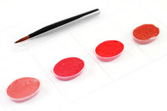 Four color lipstick samples with brush applicator Stock Images