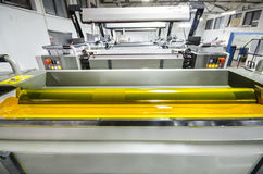 Four color print press machine, yellow color ink roller Royalty Free Stock Photos