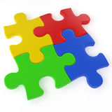 Four color puzzle pieces. Four colored puzzle pieces assembled isolated on white with a clipping path Stock Images