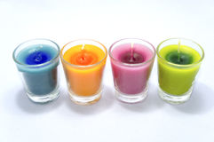 Four color scented candle. On white background Royalty Free Stock Photos