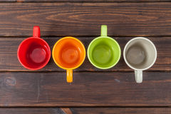 Four color tea cups Stock Photo