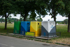 Four color trash cans (garbage bin) Stock Images