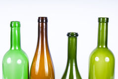 Four colored bottles Stock Photography