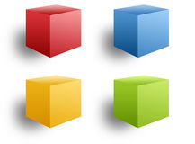 Four Colored Boxes. Four colored 3-D isolated boxes. Colors are red, blue, orange and green Royalty Free Stock Photos
