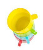 Four colored cups facing each other Royalty Free Stock Photography
