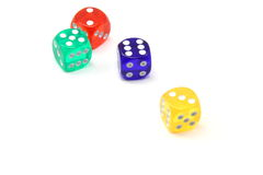 Four Colored Dice Royalty Free Stock Photo